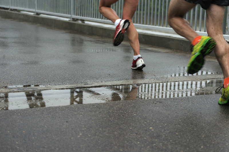 Marathon participants run over the Elm Park Bridge on Sunday morning. (Sarah Taylor / Winnipeg Free Press)