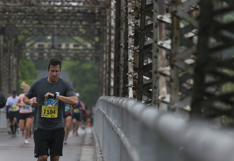 Runners head over the Elm Park Bridge an hour into the marathon.  (Sarah Taylor / Winnipeg Free Press)