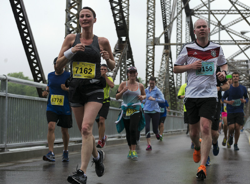 Marathon participants run over the Elm Park Bridge on Sunday morning. Sarah Taylor / Winnipeg Free Press