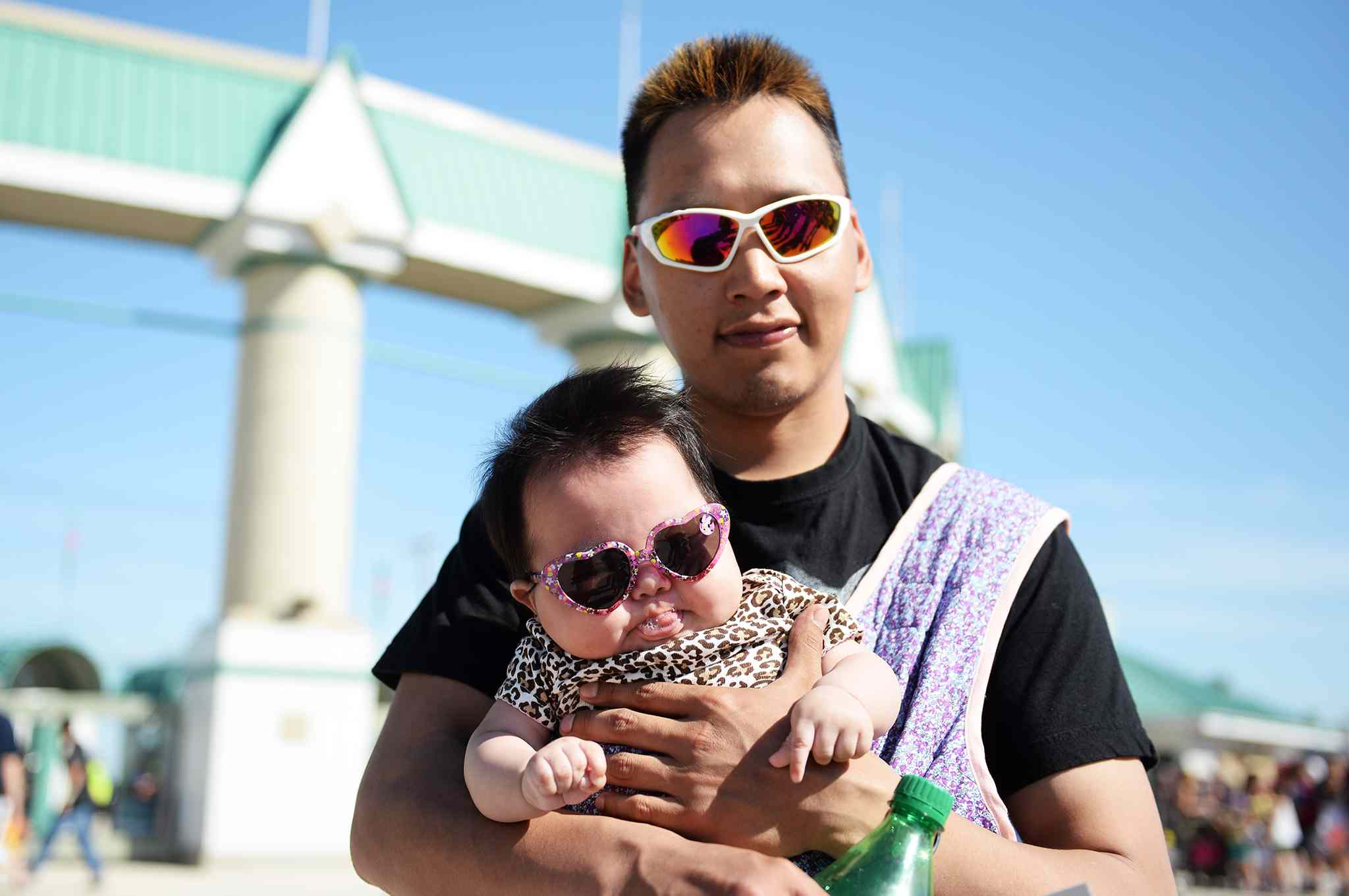 Three-month-old Janaiya with her father Matthew Issumatardiuak at the Red River Ex.