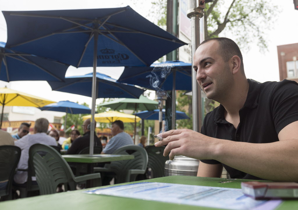 Radoslav Drandarewski enjoys a cigarette on the patio at Saffron's Wednesday. That could end if the city has its way.