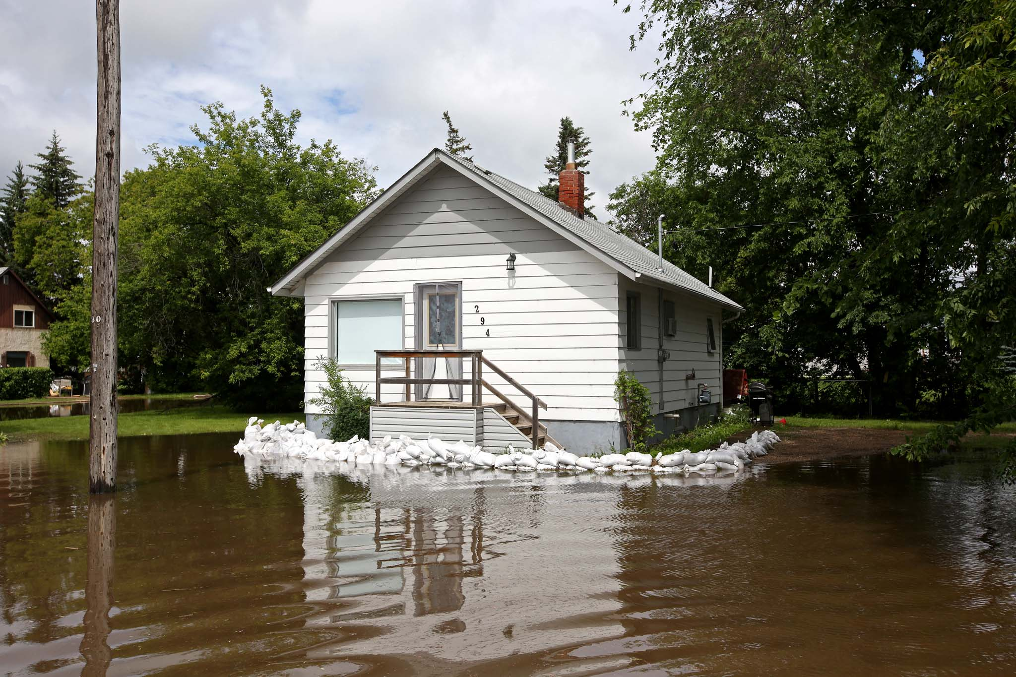 Sandbags surround a portion of a home inundated with water on King Street in the town of Virden as the Gopher Creek continued to rise on Monday.