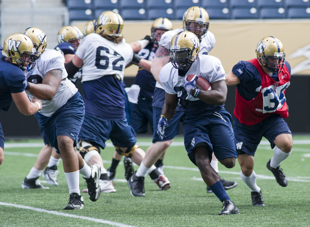 Winnipeg Blue Bombers running back Nic Grigsby works out on Monday.