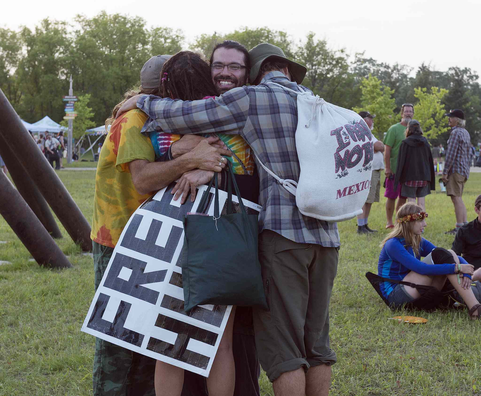 Greg Allan feels the love as he delivers free hugs at Folk Fest on Thursday.