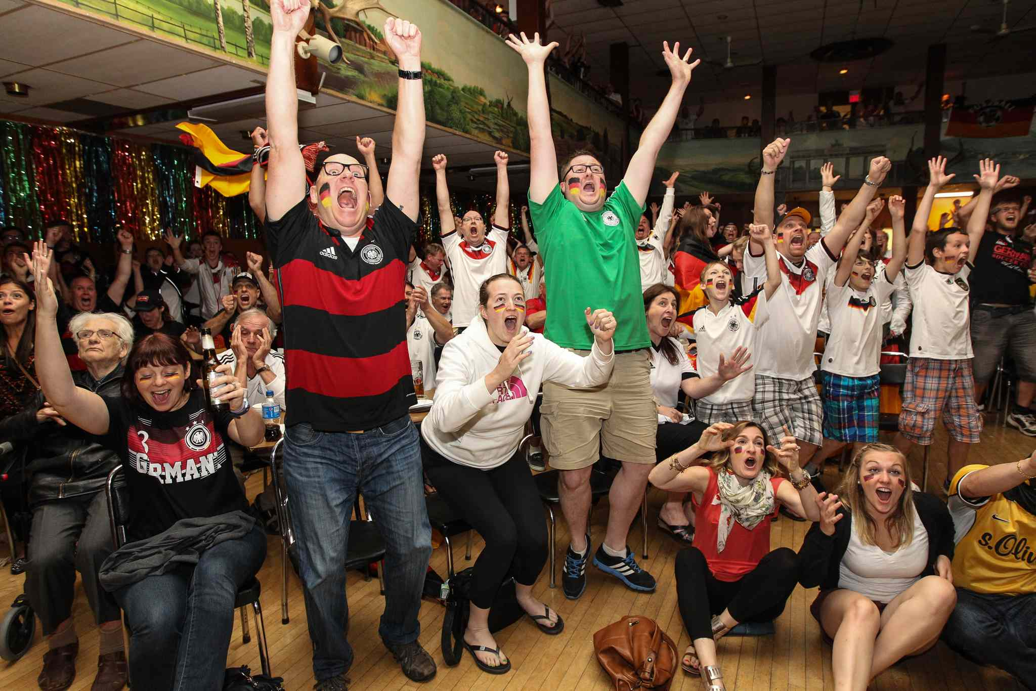 Fans celebrate Germanys World Cup win over Argentina at the German Society of Winnipeg Sunday afternoon. Nerves had been on edge until the lone, winning goal in extra time.