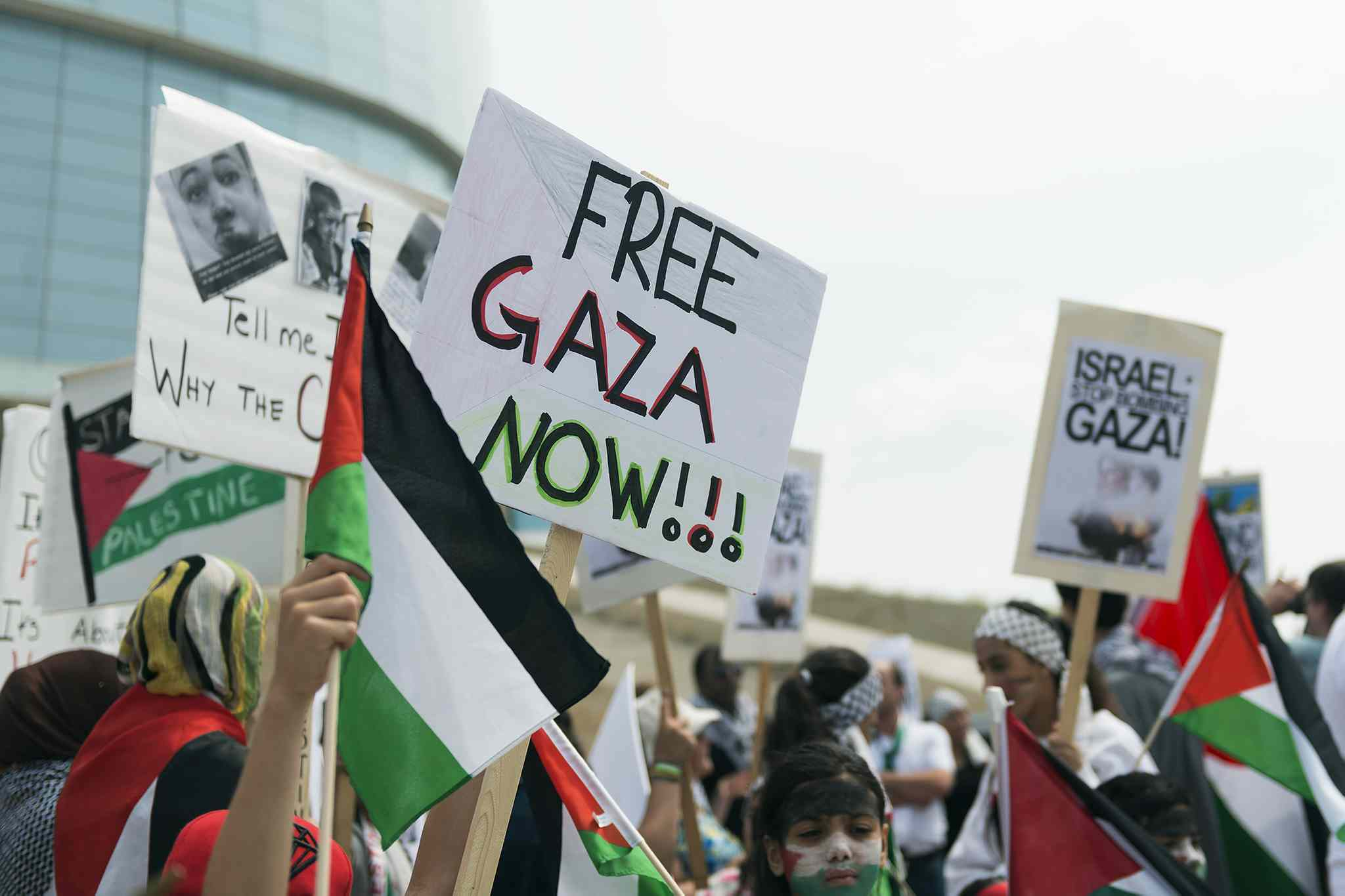 Several groups gather at the Canadian Museum for Human Rights on Saturday to rally for an end to the military assault on Gaza.