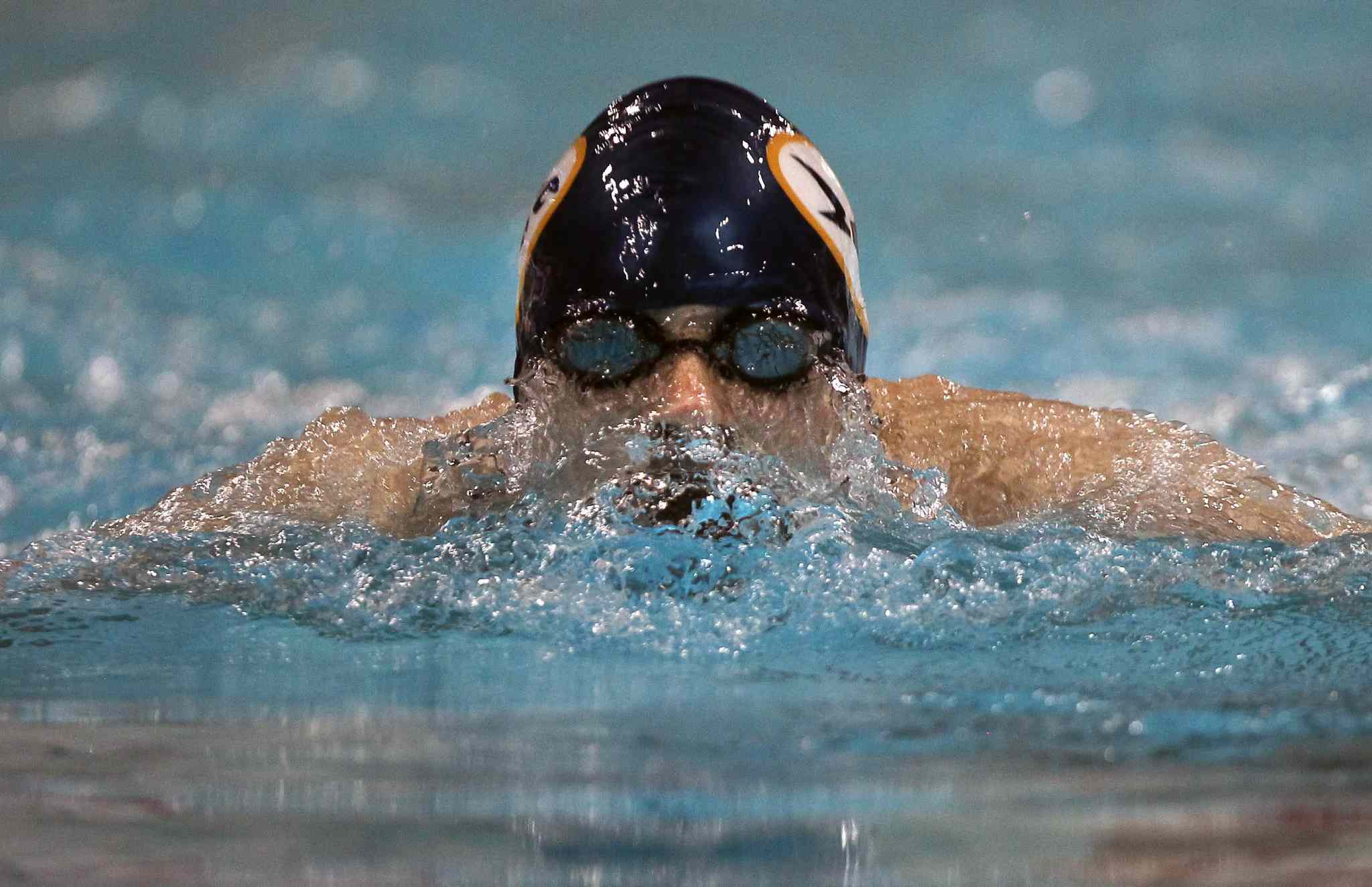 Kaelan Freund of the LA Swim Club emerges from the water during his 15 year old boys' 100m breaststroke final at the 2014 Canadian Age Group Championships at Pan Am Pool in Winnipeg. (JOE BRYKSA / WINNIPEG FREE PRESS)