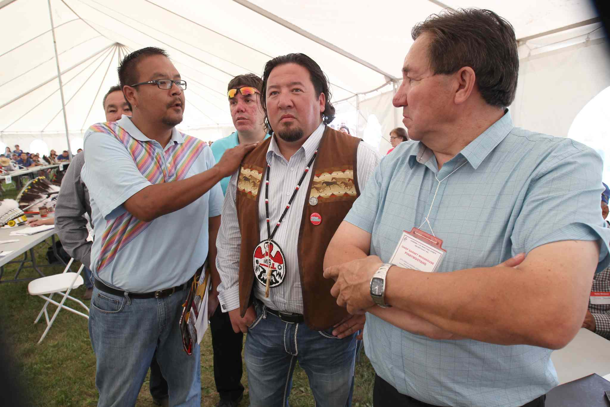 Derek Nepinak, centre, is congratulated after winning his second term as Grand Chief of the Assembly of Manitoba Chiefs Wednesday.