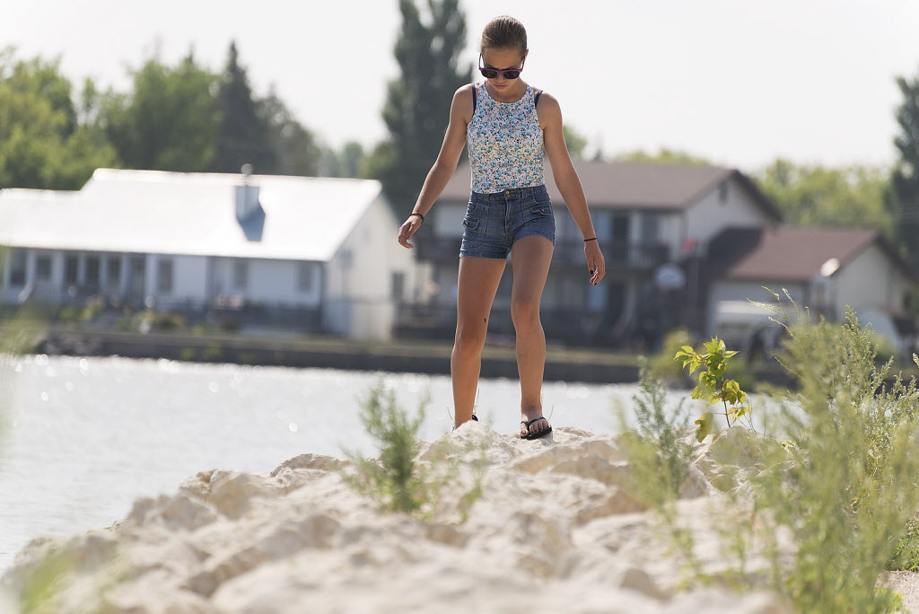 Taryn Fenez, 12, walks along the harbour front in Gimli on Saturday. She and her family attend the Icelandic festival every year.