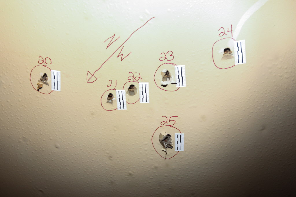 Holes in the wall are marked for police investigation.  (MIKE DEAL / WINNIPEG FREE PRESS)