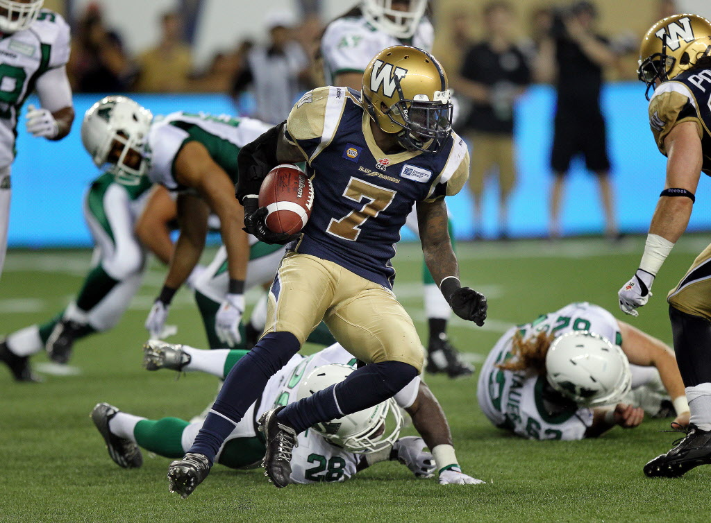 Winnipeg Blue Bombers Demond Washington (7) leaves a trail of fallen Saskatchewan Roughriders defenders behind him. (Phil Hossack / Winnipeg Free Press)