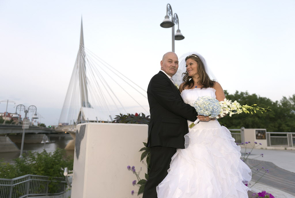 Gerald Lavergne and Shelley Carlson-Lavergne tied the knot Saturday at the Esplanade Riel Bridge. They are the first couple to wed there.  (Sarah Taylor / Winnipeg Free Press)