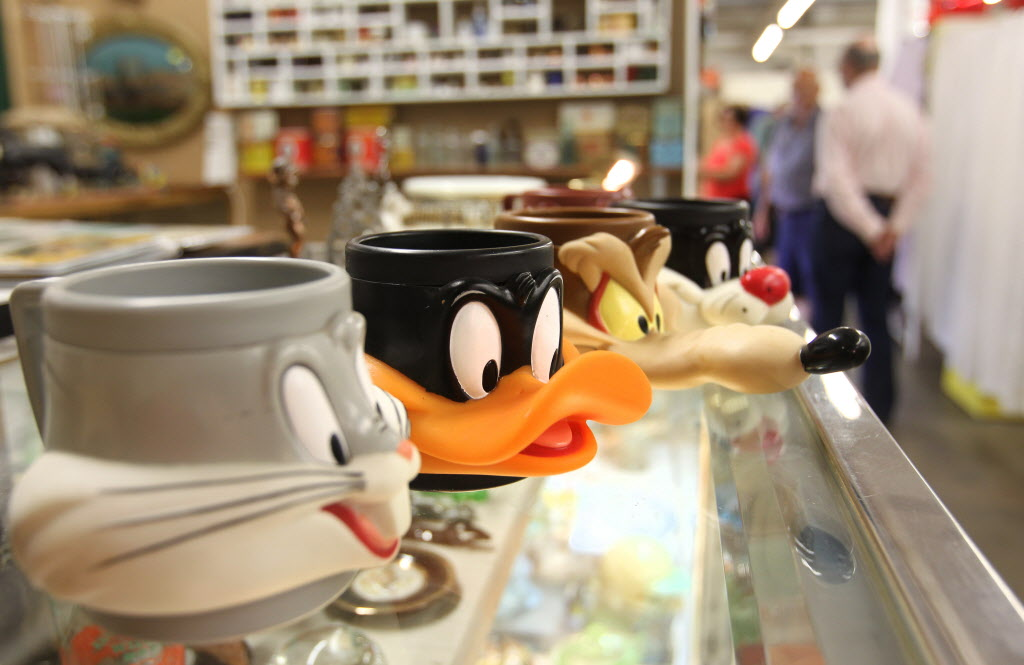 Thirsty's Flea Market at 1111 Ellice Ave. has eclectic vintage goods, including plastic Disney character cups from 1980's.   (Ruth Bonneville / Winnipeg Free Press)