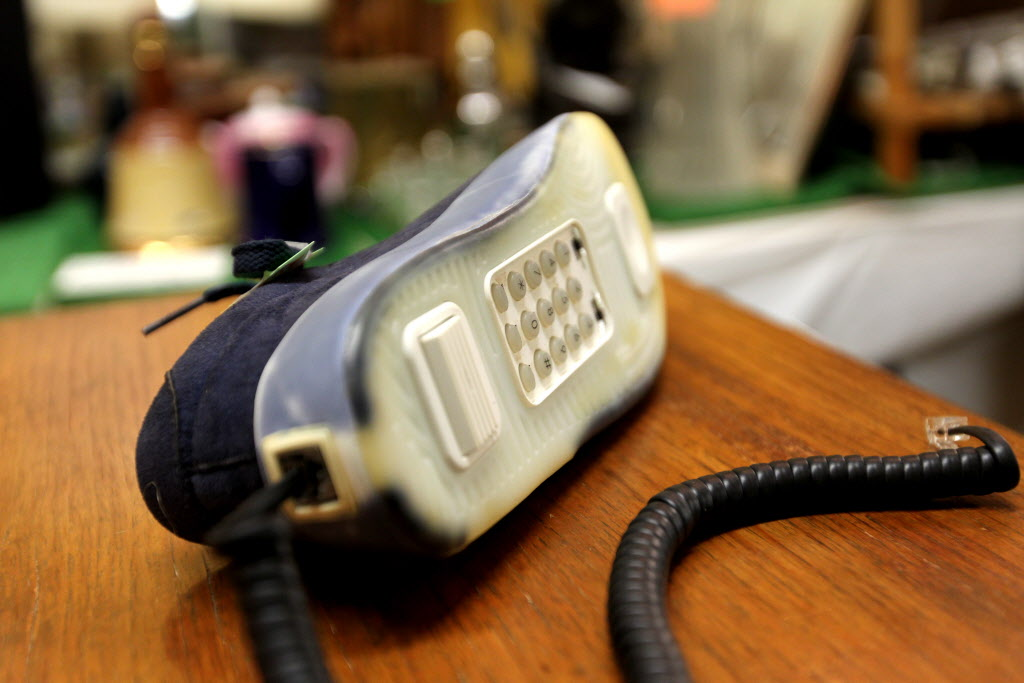 Thirsty's Flea Market at 1111 Ellice Ave. has eclectic vintage goods, including a sneaker phone.