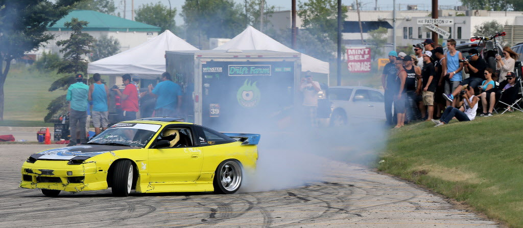 Collin Melody, from Minneapolis, Minnesota, participates in a drifting demo in front of a crowd at Springs Church on Sunday. (Trevor Hagan / Winnipeg Free Press)