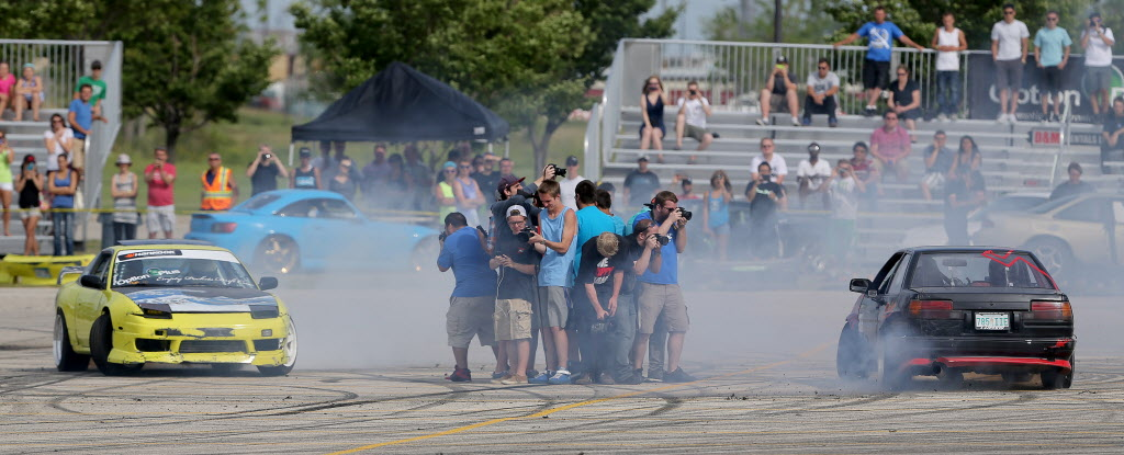 Collin Melody, from Minneapolis, Minnesota, and Kolton Ryan, from Weyburn, Saskatchewan, drift circles around a group of photographers during a drifting demo at Springs Church.