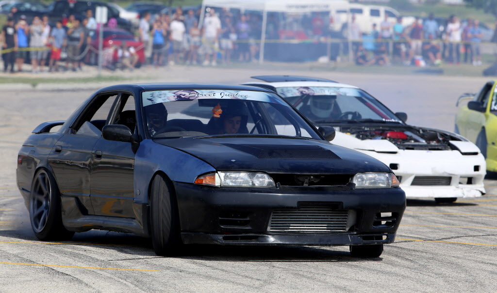 Jon Fiorante, followed by Blair McIntosh, participates in a drifting demo at Springs Church Sunday.