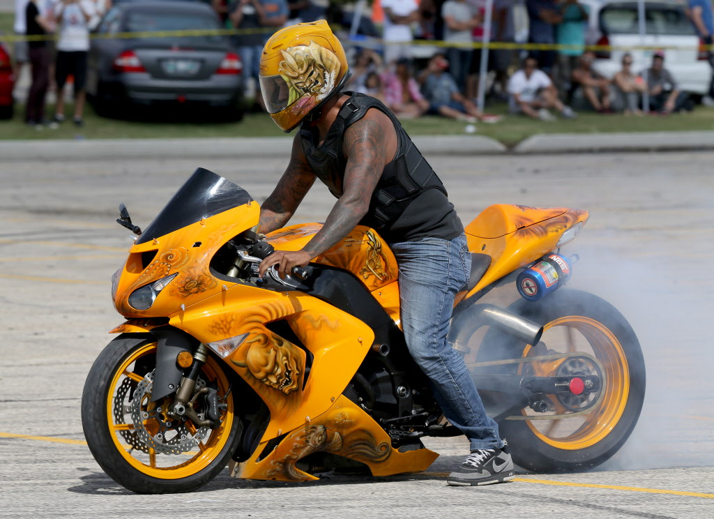 Wayne Nuytten does a burnout on his customized motorcycle during a drifting demo at Springs Church on Sunday. (Trevor Hagan / Winnipeg Free Press)