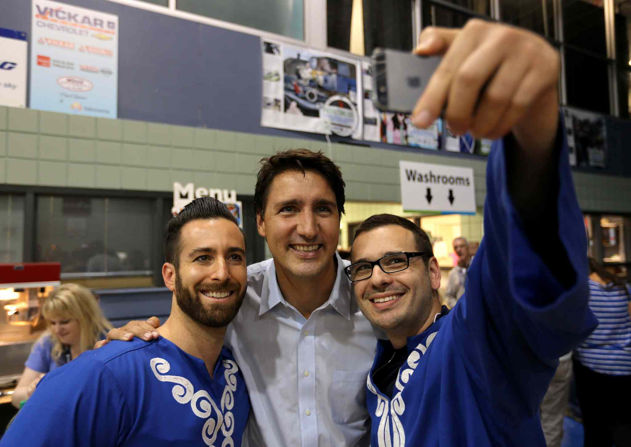 Liberal Party of Canada, Justin Trudeau, middle, poses for a selfie with dancers at the Israeli Folklorama Pavillion, Friday, August 15, 2014.