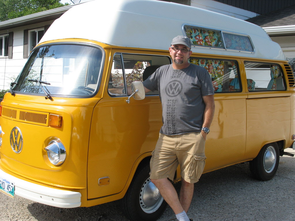Ryan Smith, the organizer of the Dubs at the Lake, with his 1974 VW Safari High Top bus.