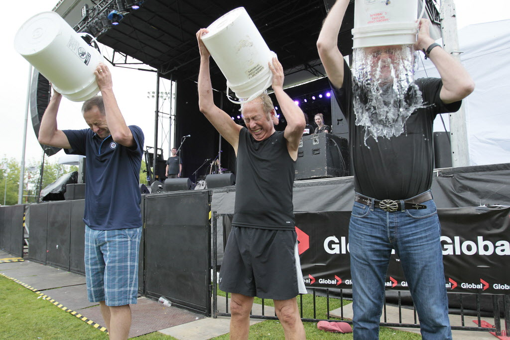 Kevin Donnelly, senior vice-president at Venues & Entertainment True North, Mayor Sam Katz and Rick Fenton, producer of Winnipeg BBQ and Blues Festival, take the ALS Ice Bucket Challenge at the Winnipeg BBQ and Blues Festival Sunday. (John Woods / Winnipeg Free Press)
