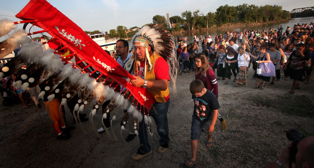 Grand Chief Derek Nepinak leads a procession from a vigil at the Alexander Docks in memory of Faron Hall and Tina Fontaine. (Phil Hossack / Winnipeg Free Press)
