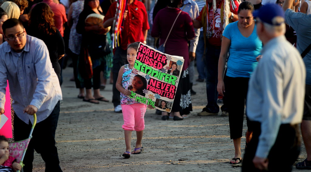 People gather for a vigil in memory of Faron Hall and Tina Fontaine.  (Phil Hossack / Winnipeg Free Press)