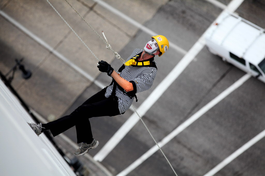 Stuart klassen rappels down the side of the wall of the RBC building, 200 feet during the annual Easter Seals Drop Zone event.