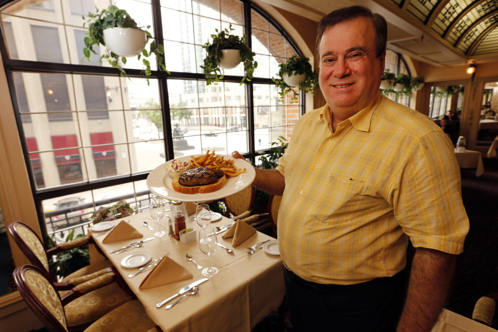 Leo Groumoutis in the Winter Garden Room at Bailey's. Groumoutis started working at Bailey's as a dishwasher when he was a teenager. He is now co-owner, with his brother, George.   (KEN GIGLIOTTI / WINNIPEG FREE PRESS)