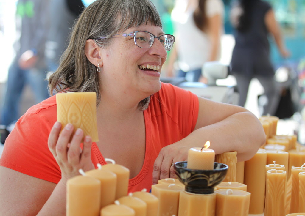Artist Gwen Fehr with Joan's Beeswax Candles shows off her candles made of natural beeswax.