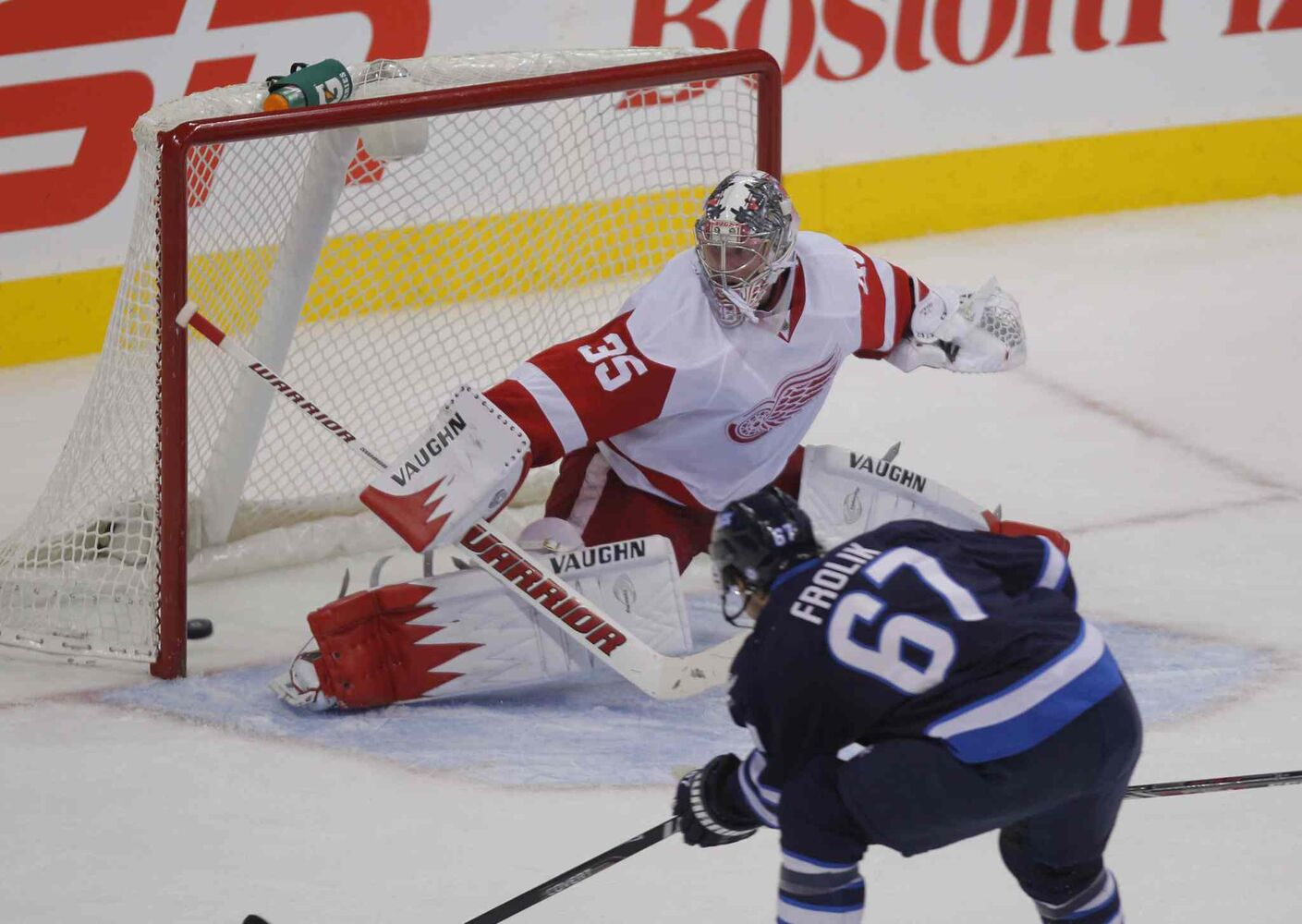 Winnipeg Jets forward Michael Frolik scores on Detroit Red Wings goalie Jimmy Howard.