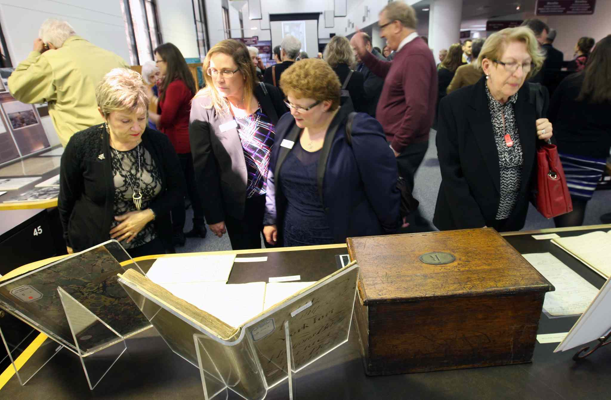 People examine HBC artifacts at the Archives of Manitoba on Tuesday.