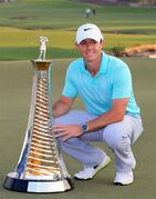Rory McIlroy of Northern Ireland holds the Race to Dubai trophy at the DP World Golf Championship in Dubai, United Arab Emirates, Sunday, Nov. 23, 2014. (AP Photo)