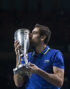 Croatia's Marin Cilic kisses the trophy after defeating Spain's Roberto Bautista Agut at the final match at the Kremlin Cup tennis tournament in Moscow in Moscow, Russia, Sunday, Oct. 19, 2014. (AP Photo/Pavel Golovkin)