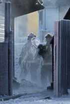 Winnipeg firefighters battle the extreme cold, with temperatures nearing - 30 C as well as the fire.
