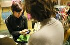 Stores ditch cash registers, allow sales staff and shoppers to checkout on phones and tablets