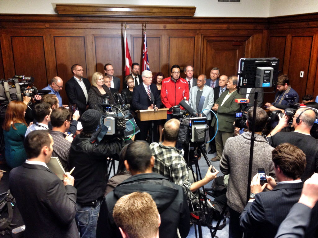 Surrounded by caucus members, Premier Greg Selinger told the media last Tuesday he is staying put. Five dissidents have called for him to step down because of low polling numbers.