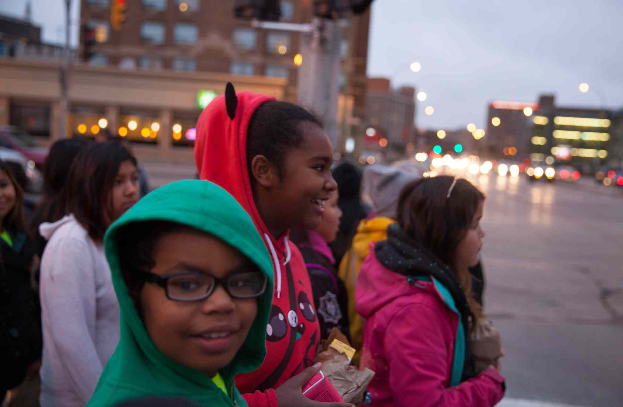 Kassidy Bone (foreground) and Deevah Clearsky laugh as they walk along Portage Avenue on their way to MTS Centre for We Day.