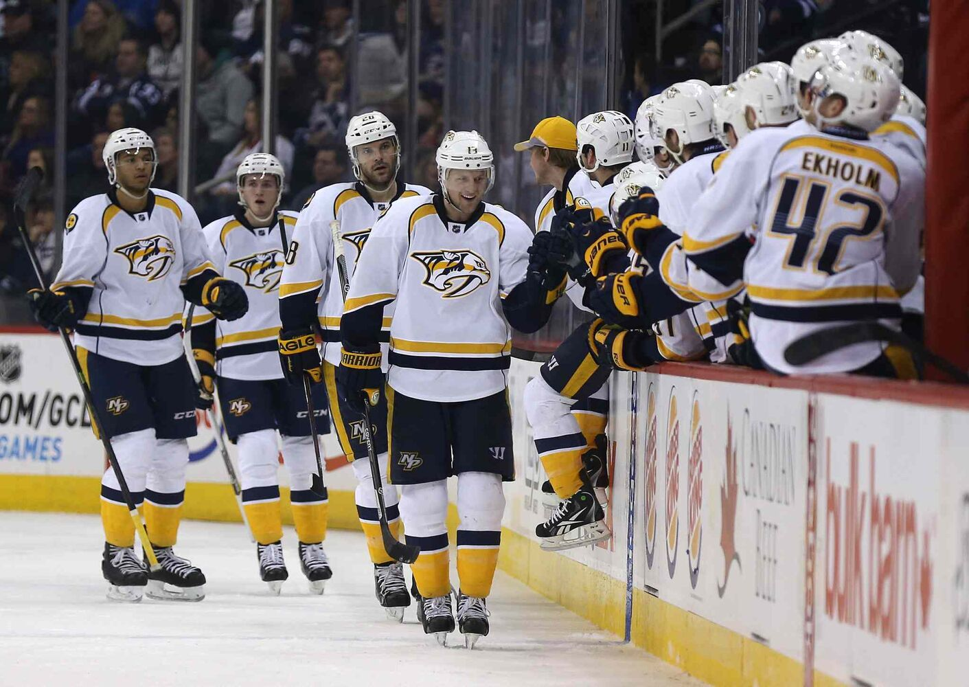 Nashville Predators players celebrate a second-period goal by Nick Spaling (13) against the Winnipeg Jets at the MTS Centre Tuesday. (Trevor Hagan / The Canadian Press)