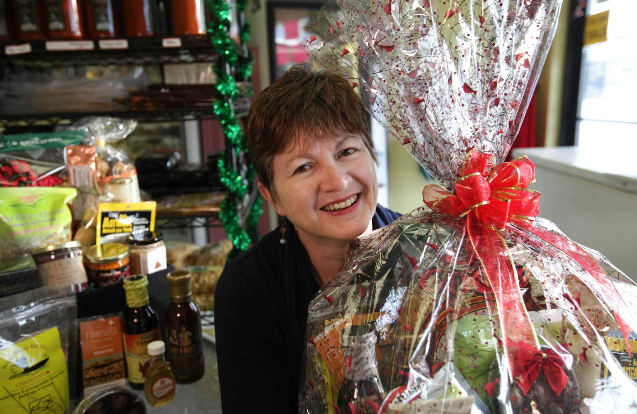 Carla Dayholos assembles made-in-Manitoba gift baskets filled with locally made products through