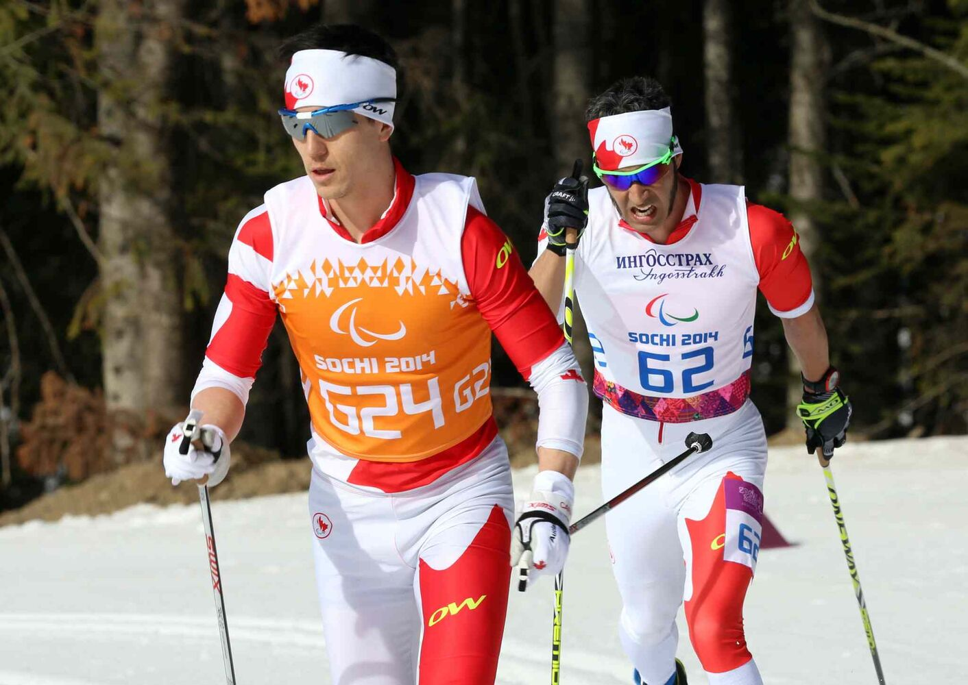 Canadian Brian McKeever (right) and guide Graham Nishikawa compete in the men's visually impaired 20-kilometre race at the Sochi 2014 Paralympic Winter Games in Sochi Russia on Monday March 10, 2014.  (Scott Grant / Canadian Paralympic Committee)