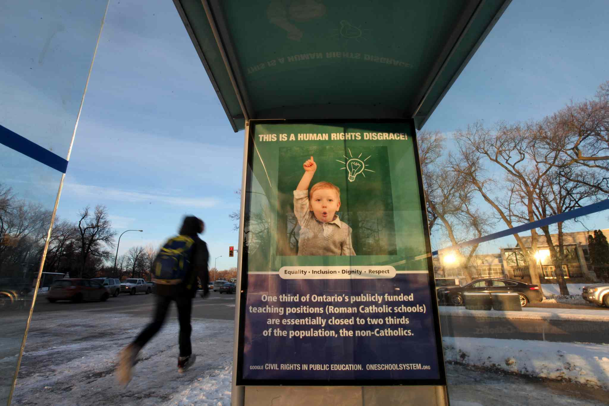 An ad about Ontario's public school funding is seen at the bus shelter on Academy Road at Wellington Crescent.