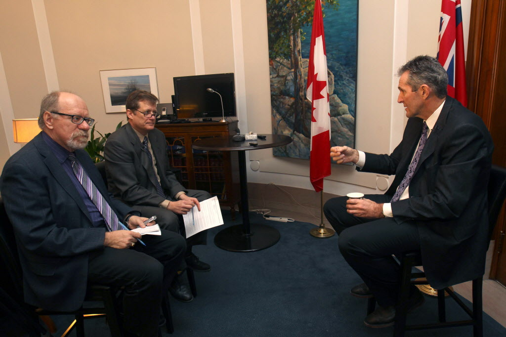 Free Press legislature reporters Larry Kusch (from left) and Bruce Owen interview Progressive Conservative Leader Brian Pallister in mid-December.