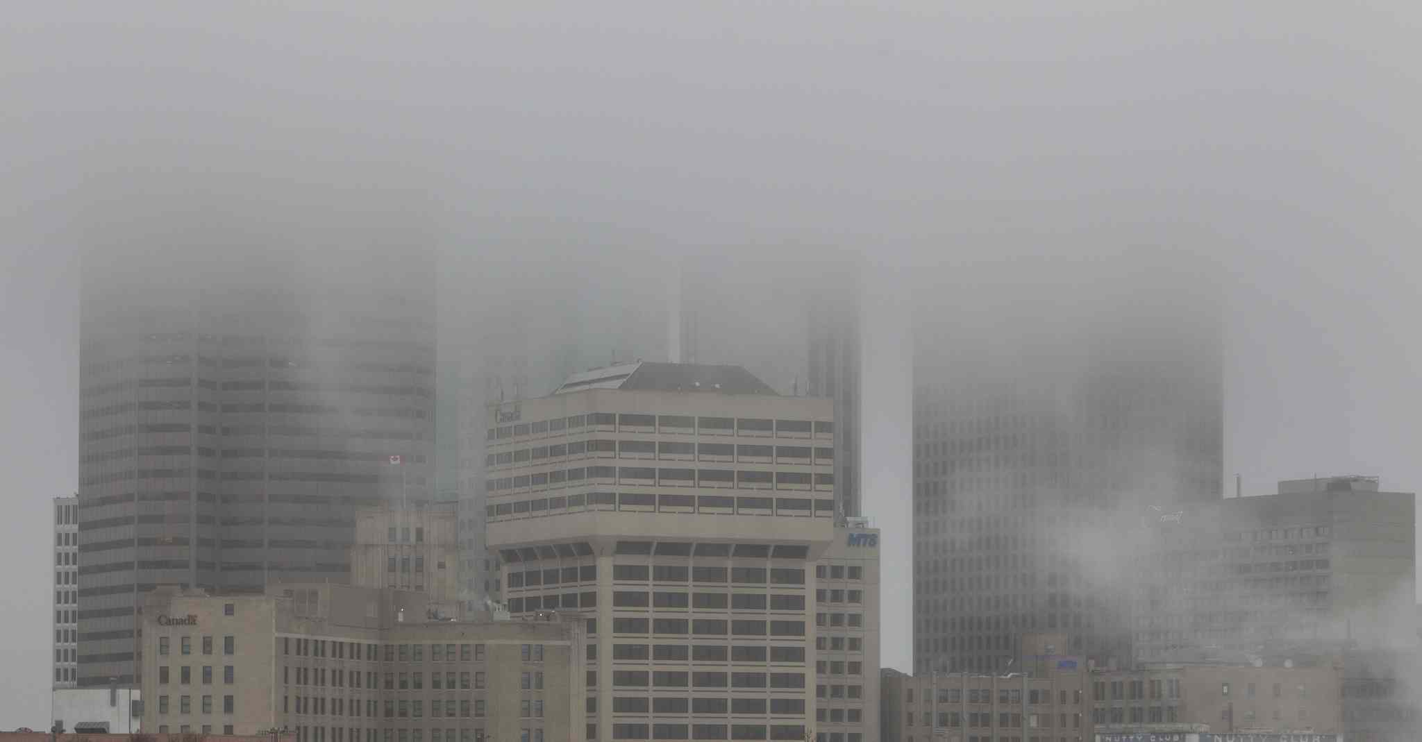 Winnipeg's downtown skyscrapers were covered in low hanging clouds Sunday morning.