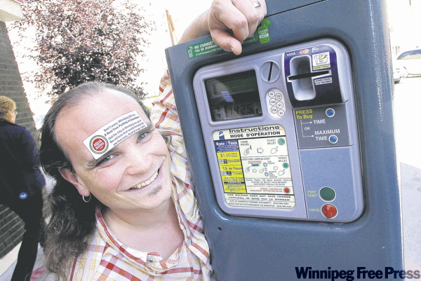 Aqua Books owner Kelly Hughes wants to know why the city hasn't put stickers on paystations advising drivers they have two hours of free parking on Saturdays.