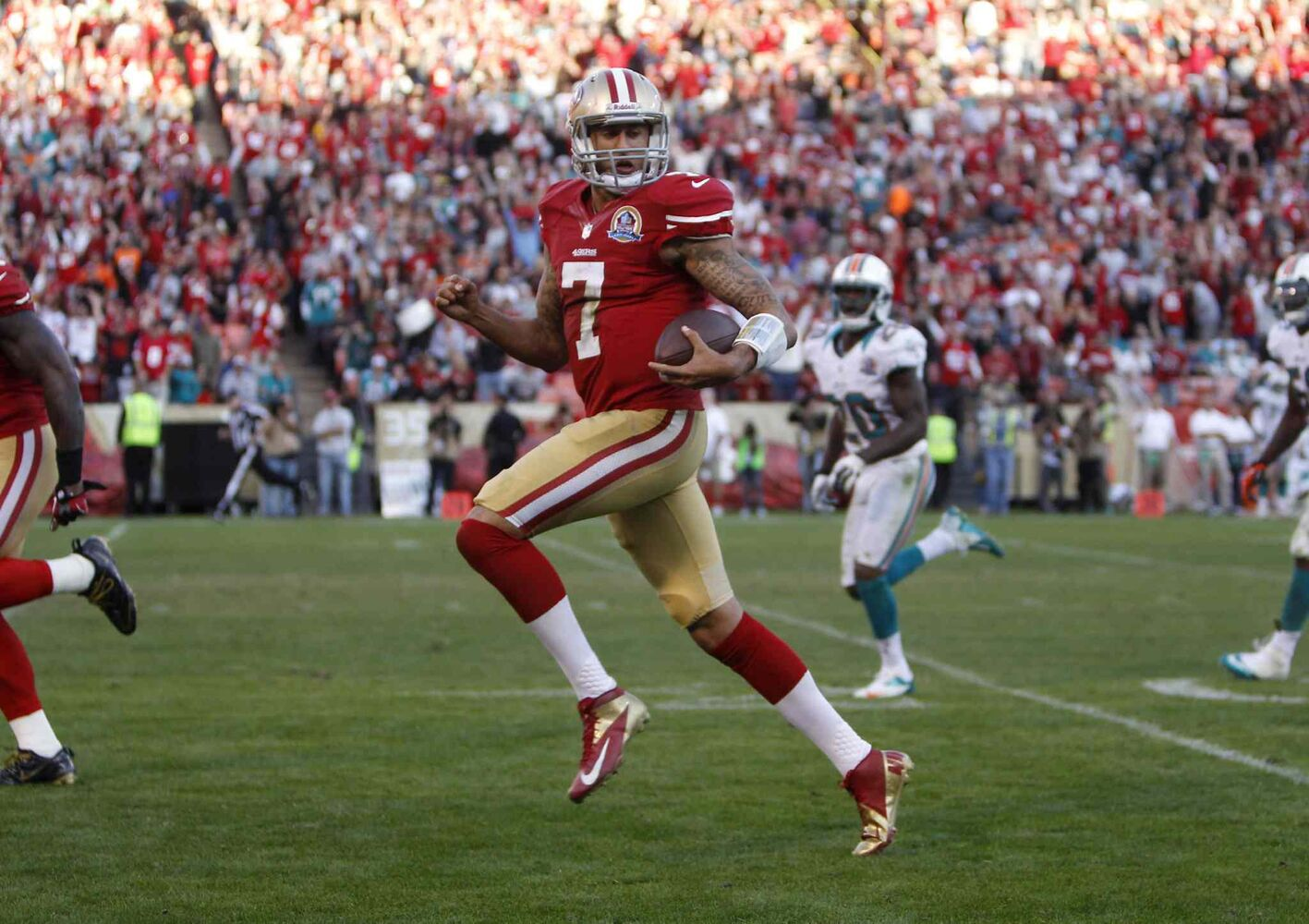 San Francisco 49ers' starting quarterback Colin Kaepernick (7) scores a touchdown against the Miami Dolphins in the fourth quarter of a December 2012 game. The San Francisco 49ers defeated the Miami Dolphins, 27-13. (Nhat V. Meyer / San Jose Mercury News / MCT files)