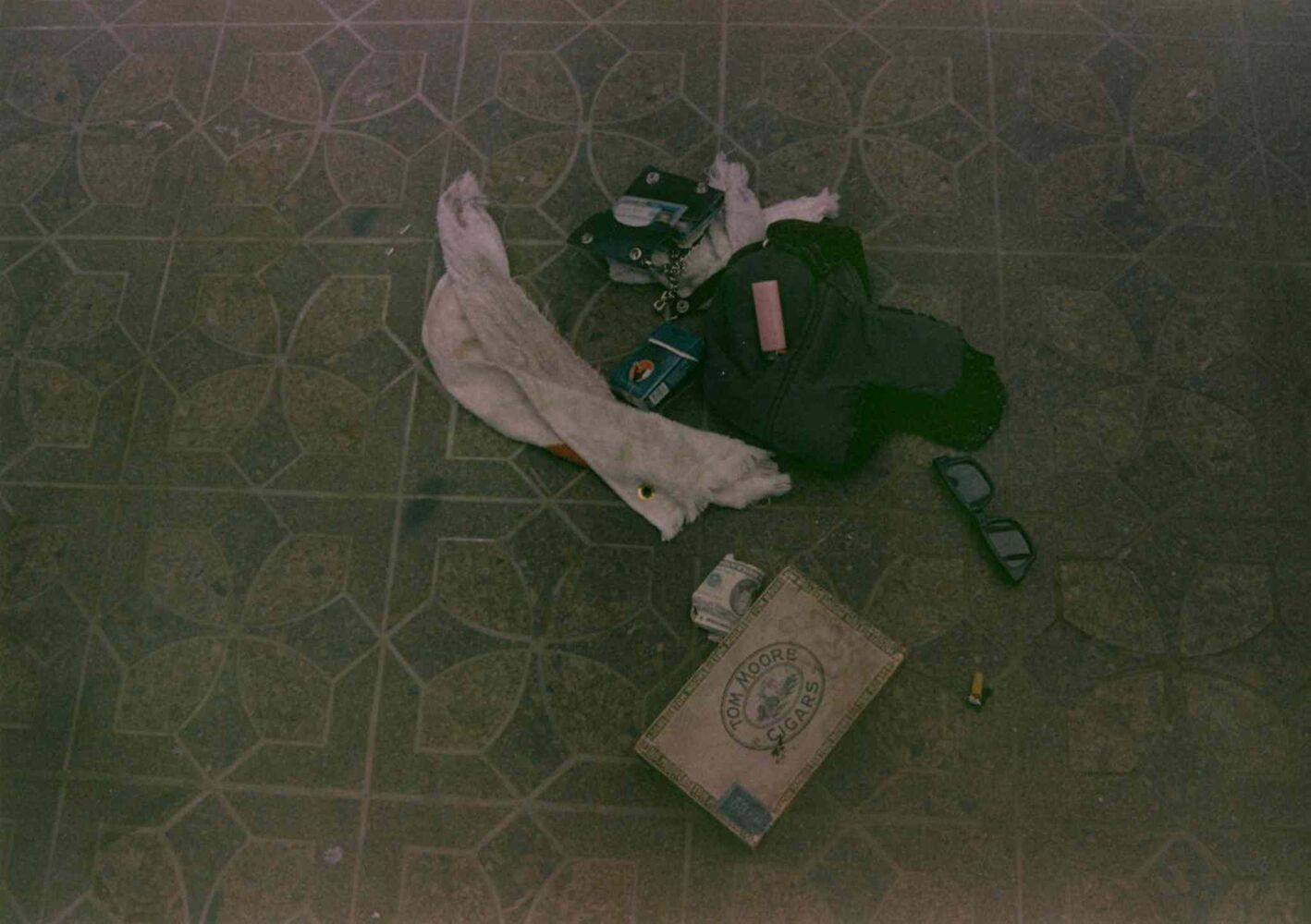Seattle Police released in March 2014 two new photographs from the scene where Kurt Cobain's body was found in 1994. One photograph shows a cigar box on the floor near Cobain's body, as well as cash, a woolly hat and an open wallet displaying the singer's ID. (Seattle Police Department)
