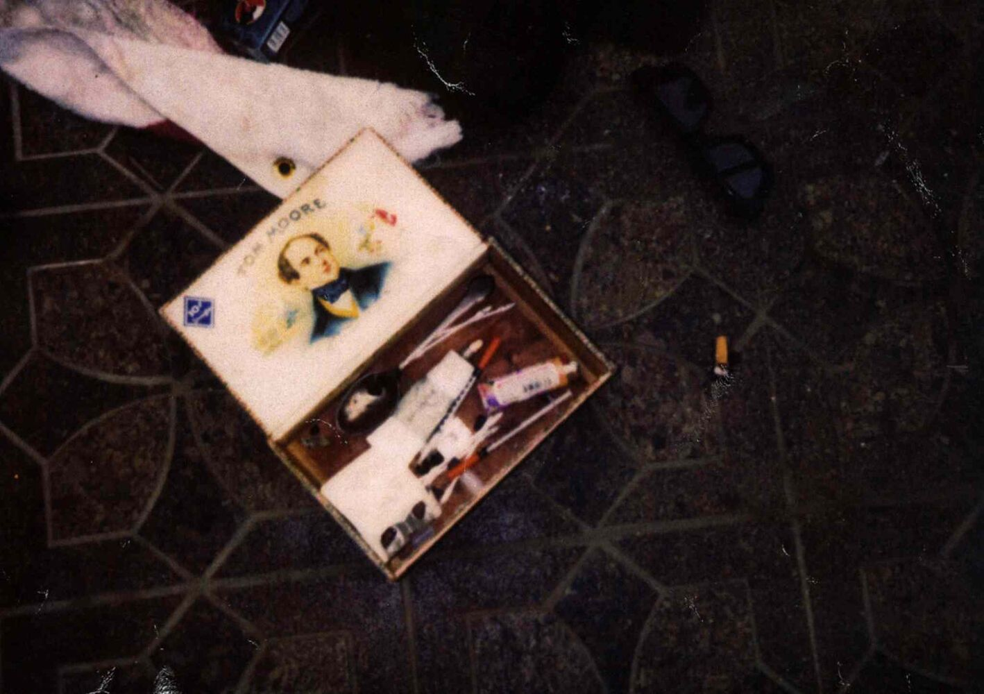 The second new photograph showed the contents the inside of a box found near Kurt Cobain's body. The box contained drug paraphernalia. (Seattle Police Department)