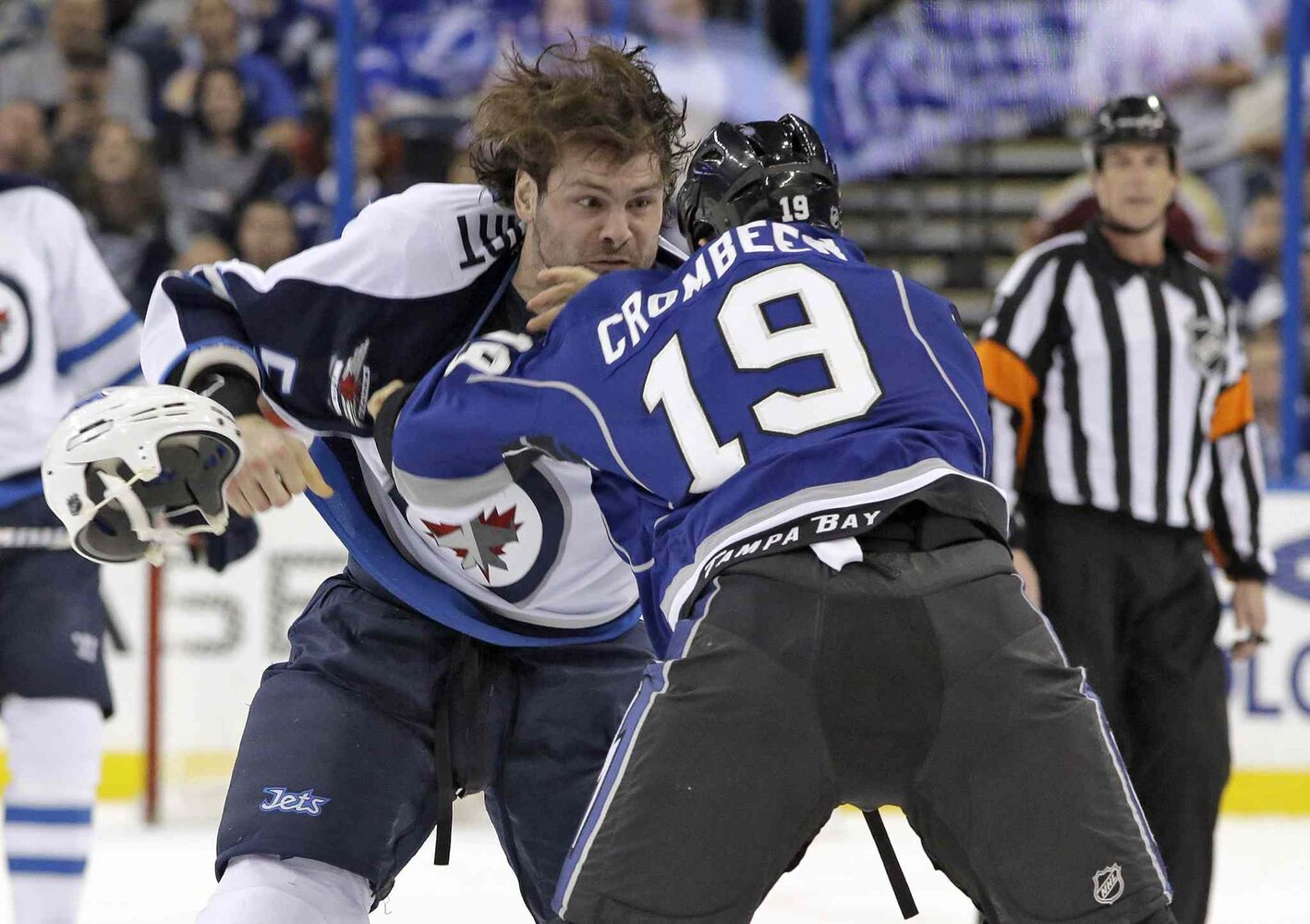 Winnipeg Jets defenceman Mark Stuart (left) loses his helmet during his fight with Tampa Bay Lightning winger B.J. Crombeen during the first period.