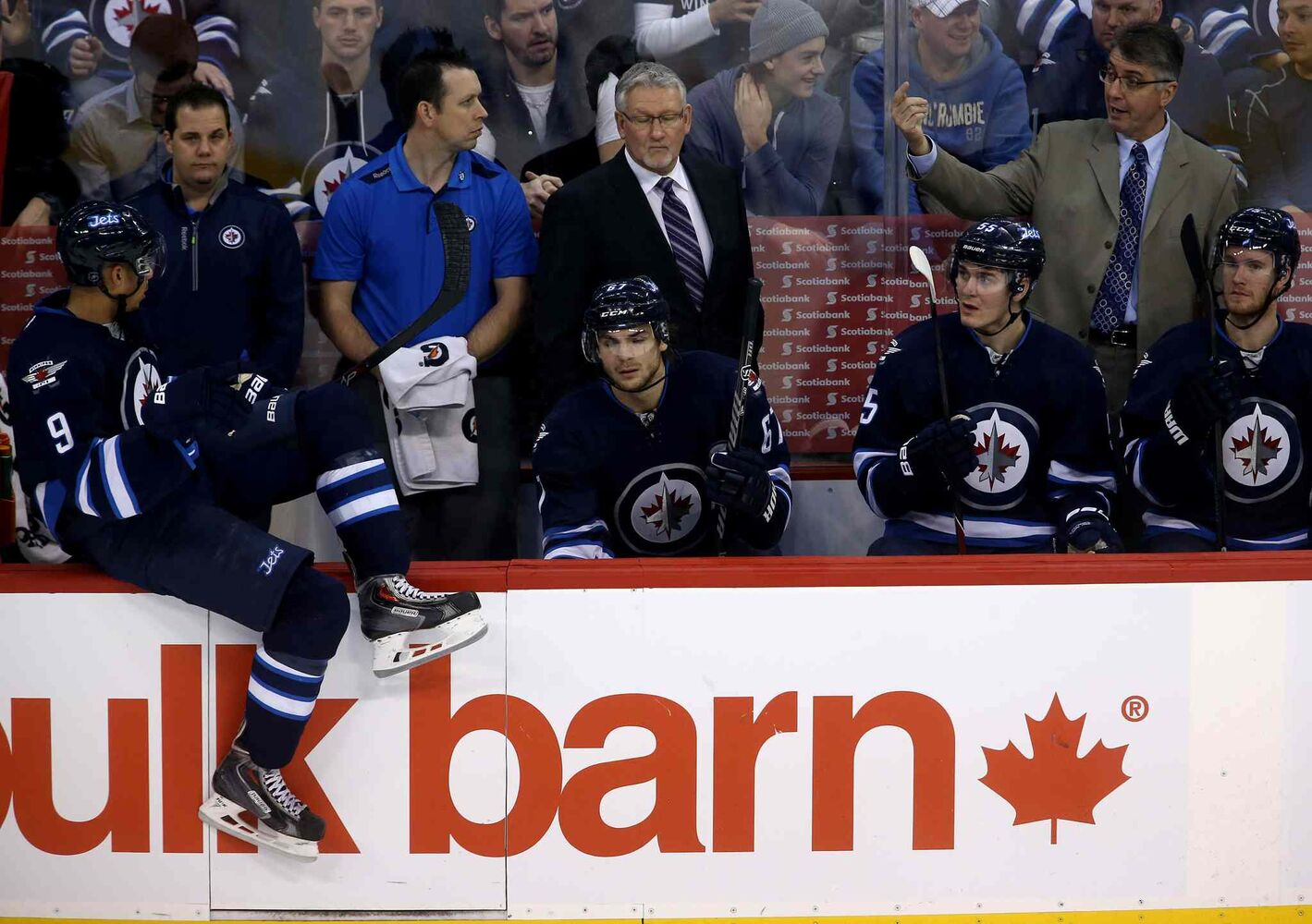 Winnipeg Jets' Evander Kane (left) listens to instructions from Winnipeg Jets head coach Claude Noel (top right) during the third period. (TREVOR HAGAN / WINNIPEG FREE PRESS)